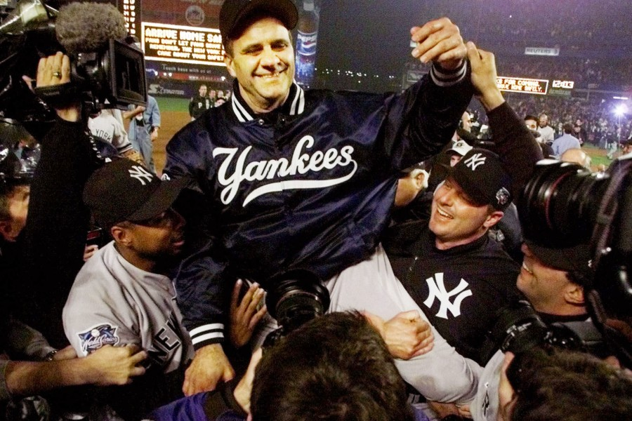 080403 -   For Yankee 100 special.New York Yankees manager Joe Torre is carried off the field by players Bernie Williams, left, and Roger Clemens, right, after clinching the World Series by beating the New York Mets 4-2 in Game 5 of the World Series Firday, Oct. 27, 2000, at Shea Stadium in New York. (AP Photo/Amy Sancetta ).  For Yankees 100 special.