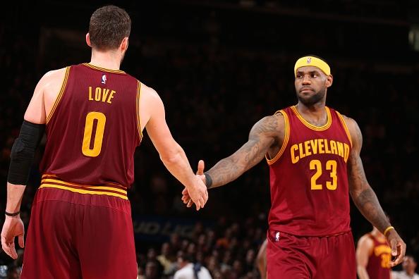 lebron-james-23-high-fives-teammate-kevin-love
